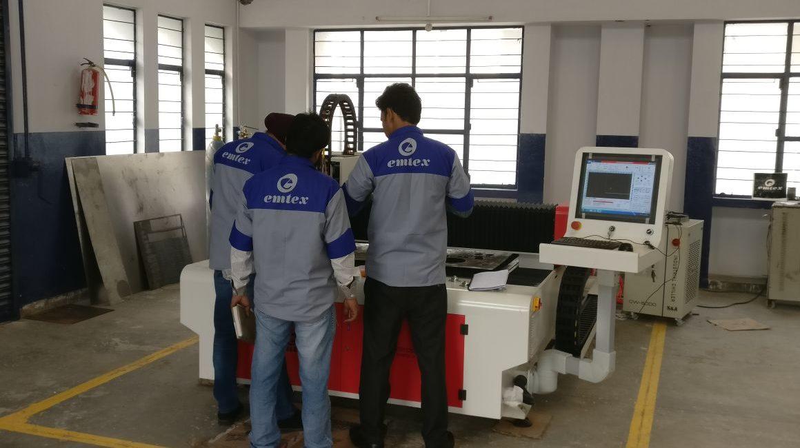 Engineers Testing Laser Cutting Machine - Emtex Manufacturing